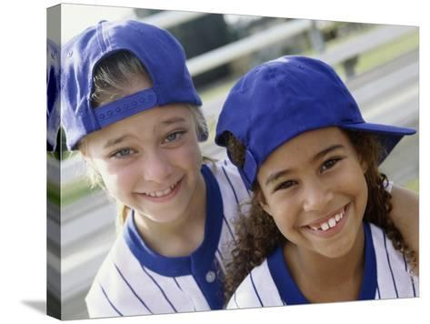 Portrait of Two Girls in Baseball Uniforms--Stretched Canvas Print