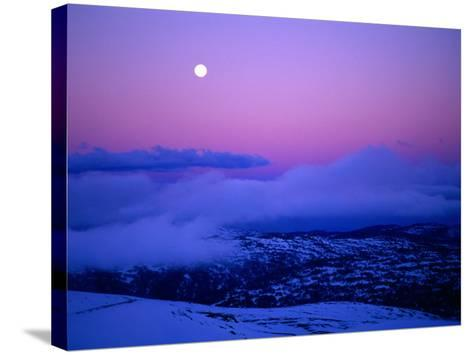 Moonrise and Sunset on Main Range in Winter, Kosciuszko National Park, New South Wales, Australia-Grant Dixon-Stretched Canvas Print