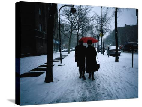 Walking on Snowy Winter Street, New York City, New York, USA-Angus Oborn-Stretched Canvas Print
