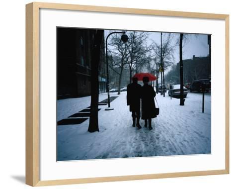 Walking on Snowy Winter Street, New York City, New York, USA-Angus Oborn-Framed Art Print