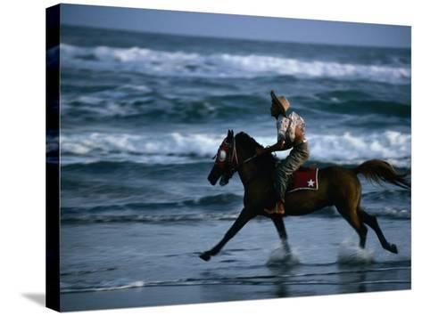 Boy Riding Pony on Beach Parangtritis, Central Java, Indonesia-Phil Weymouth-Stretched Canvas Print
