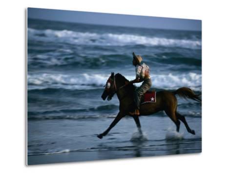 Boy Riding Pony on Beach Parangtritis, Central Java, Indonesia-Phil Weymouth-Metal Print