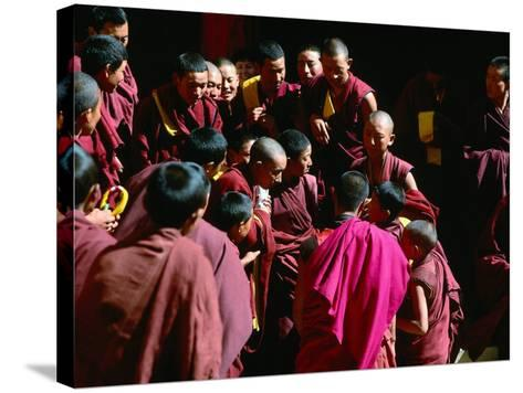 Monks Gathered in Courtyard of Historic Ganden Monastery, Ganden, Tibet-Richard I'Anson-Stretched Canvas Print