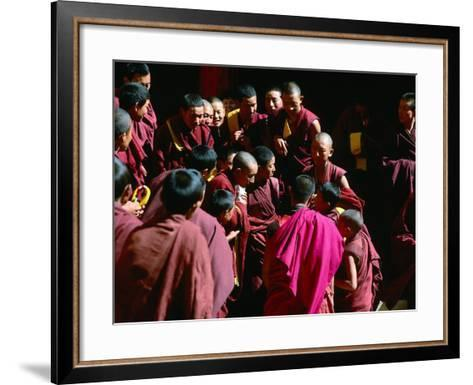 Monks Gathered in Courtyard of Historic Ganden Monastery, Ganden, Tibet-Richard I'Anson-Framed Art Print