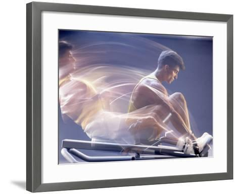 Man Using Rowing Machine-Daniel Fort-Framed Art Print