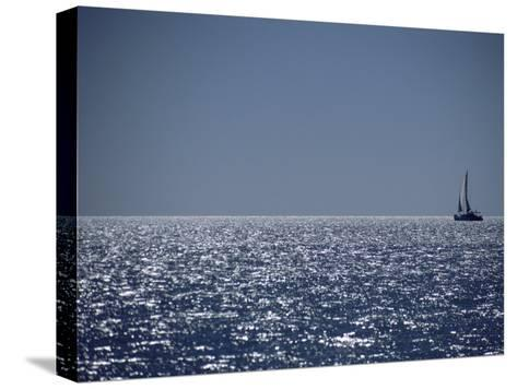 A Lone Sailboat on the Horizon in Shark Bay-Jason Edwards-Stretched Canvas Print