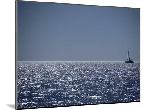 A Lone Sailboat on the Horizon in Shark Bay-Jason Edwards-Mounted Photographic Print