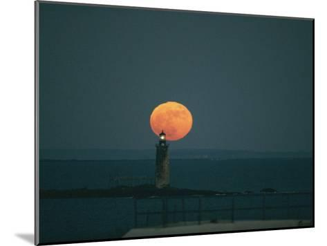 A Lighthouses Silhouette against a Full Moon-Bill Curtsinger-Mounted Photographic Print