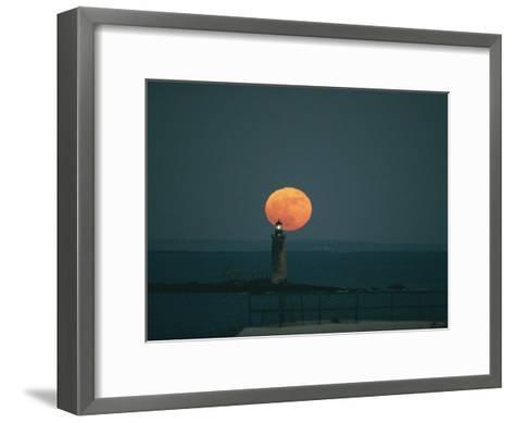 A Lighthouses Silhouette against a Full Moon-Bill Curtsinger-Framed Art Print