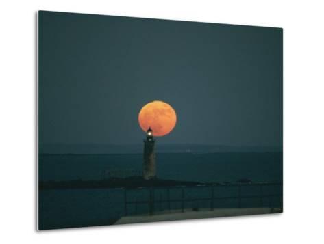 A Lighthouses Silhouette against a Full Moon-Bill Curtsinger-Metal Print