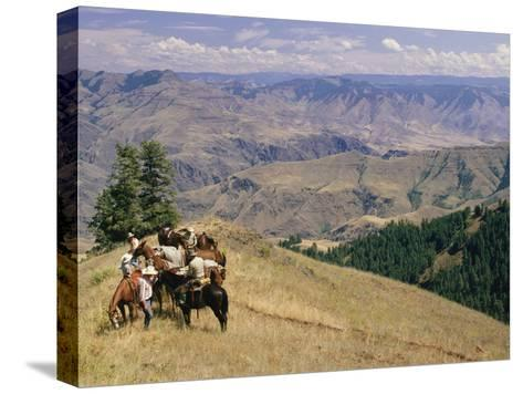 A Group of Horseback-Riding Tourists Take in the View of Hells Canyon-Richard Nowitz-Stretched Canvas Print