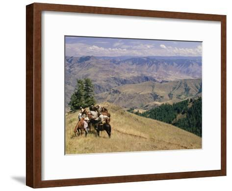 A Group of Horseback-Riding Tourists Take in the View of Hells Canyon-Richard Nowitz-Framed Art Print