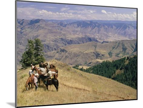 A Group of Horseback-Riding Tourists Take in the View of Hells Canyon-Richard Nowitz-Mounted Photographic Print