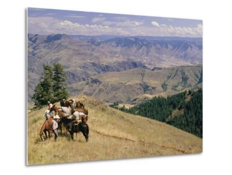 A Group of Horseback-Riding Tourists Take in the View of Hells Canyon-Richard Nowitz-Metal Print