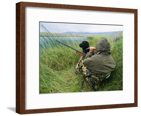 A Hunter Using a Goose Call by a Small Pond in Wyoming-Gordon Wiltsie-Framed Art Print