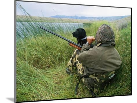 A Hunter Using a Goose Call by a Small Pond in Wyoming-Gordon Wiltsie-Mounted Photographic Print
