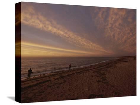 Fishermen Fishing in the Surf at Sunset-Todd Gipstein-Stretched Canvas Print