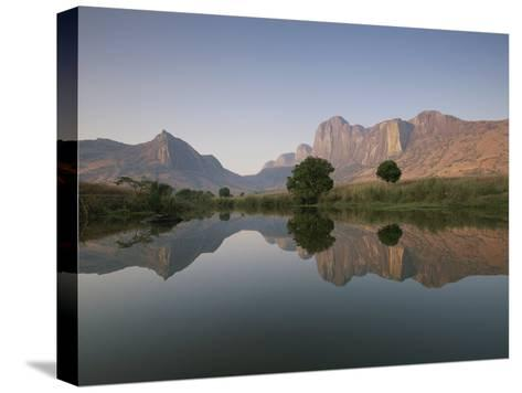 Limestone Rock Formations are Reflected in Still Waters-Michael Melford-Stretched Canvas Print