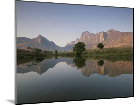 Limestone Rock Formations are Reflected in Still Waters-Michael Melford-Mounted Photographic Print