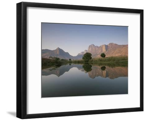Limestone Rock Formations are Reflected in Still Waters-Michael Melford-Framed Art Print