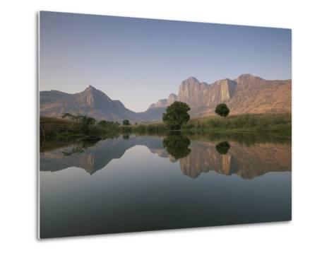 Limestone Rock Formations are Reflected in Still Waters-Michael Melford-Metal Print