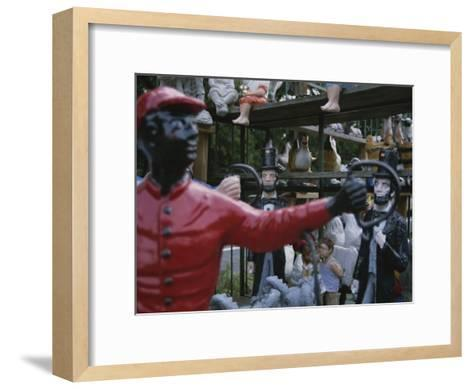 A Curious Mixture of Lawn Ornaments Includes Lincolns and Jockeys-Stephen St^ John-Framed Art Print