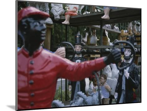 A Curious Mixture of Lawn Ornaments Includes Lincolns and Jockeys-Stephen St^ John-Mounted Photographic Print