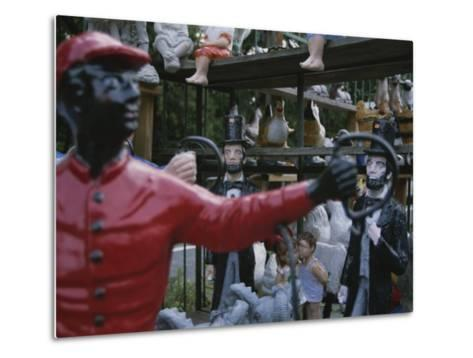 A Curious Mixture of Lawn Ornaments Includes Lincolns and Jockeys-Stephen St^ John-Metal Print