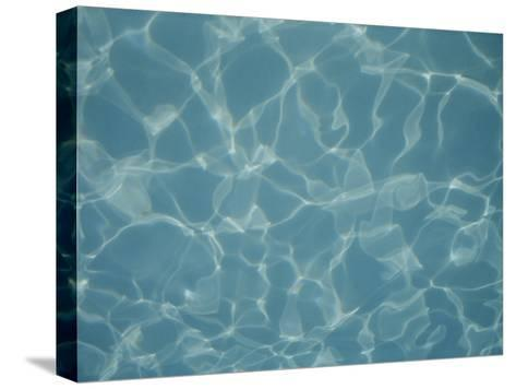 Abstract Patterns of Refracted Sunlight Dance in a Swimming Pool-Stephen St^ John-Stretched Canvas Print