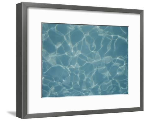 Abstract Patterns of Refracted Sunlight Dance in a Swimming Pool-Stephen St^ John-Framed Art Print