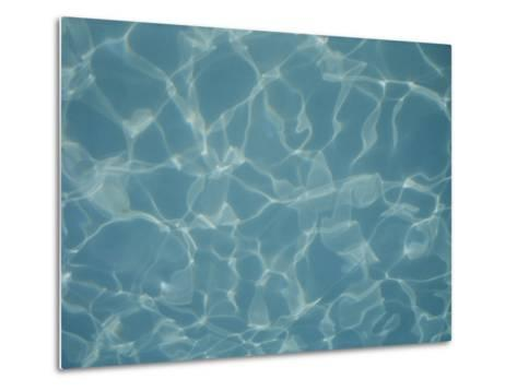 Abstract Patterns of Refracted Sunlight Dance in a Swimming Pool-Stephen St^ John-Metal Print