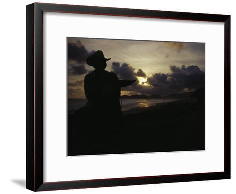 A Cowboy on His Horse Enjoys Sunrise on a Beach-Raul Touzon-Framed Art Print
