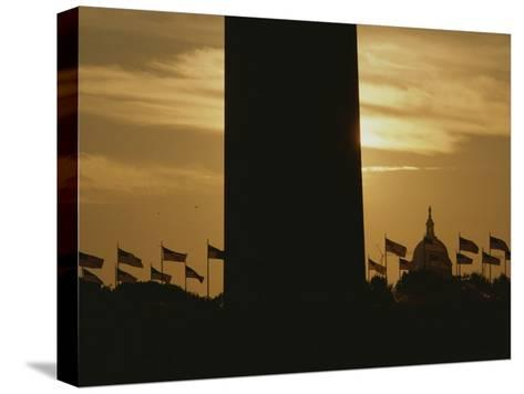 A Twilight View of American Flags Flying at the Washington Monument-Karen Kasmauski-Stretched Canvas Print