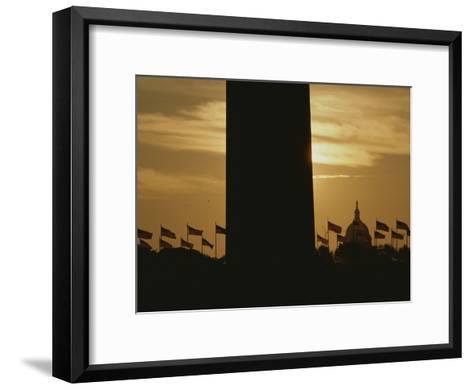 A Twilight View of American Flags Flying at the Washington Monument-Karen Kasmauski-Framed Art Print