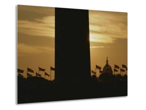 A Twilight View of American Flags Flying at the Washington Monument-Karen Kasmauski-Metal Print