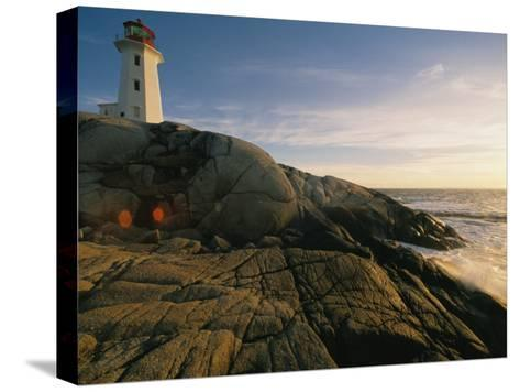 A Twilight View of the Peggys Cove Lighthouse Atop Smooth Rock-Michael S^ Lewis-Stretched Canvas Print