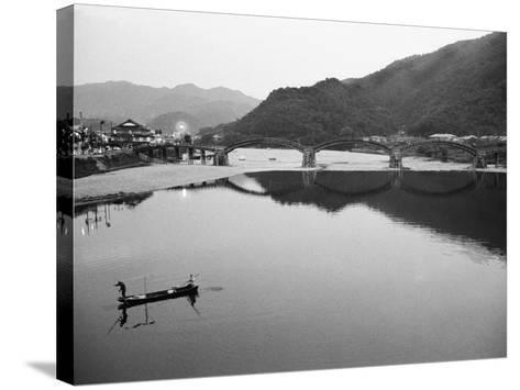 Fishermen and Historic Bridge, Iwakuni, Japan-Walter Bibikow-Stretched Canvas Print