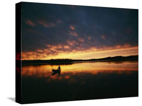 A Canoe at Sunset in East Manitoba-Bill Curtsinger-Stretched Canvas Print
