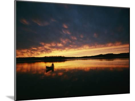 A Canoe at Sunset in East Manitoba-Bill Curtsinger-Mounted Photographic Print