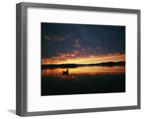 A Canoe at Sunset in East Manitoba-Bill Curtsinger-Framed Art Print