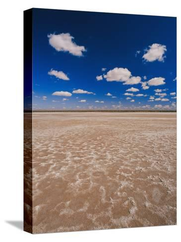 A Vivid Blue Sky Above Sand and Shallow Water-Jason Edwards-Stretched Canvas Print