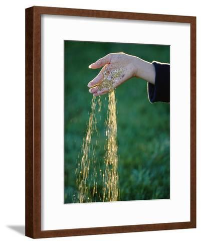 Small Glass Beads Fall Like Rain from a Womans Hand-Paul Chesley-Framed Art Print