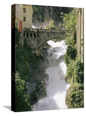 Footbridge over a Waterfall in Badgastein-Walter Meayers Edwards-Stretched Canvas Print