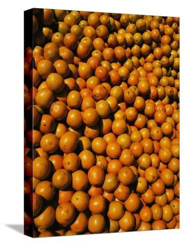 Huge Crates of Sun-Ripened Oranges at a Florida Fruit Stand-Stephen St^ John-Stretched Canvas Print