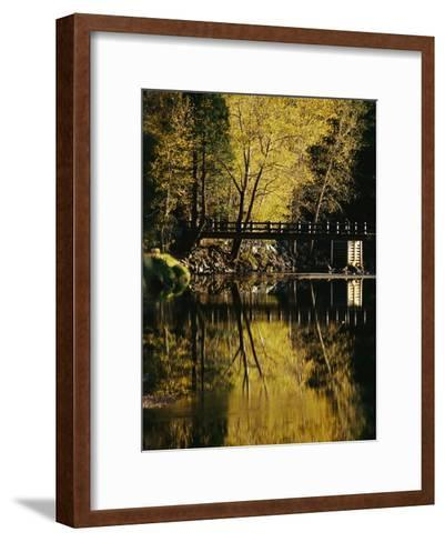 Trees and a Footbridge are Reflected in the Merced River-Marc Moritsch-Framed Art Print