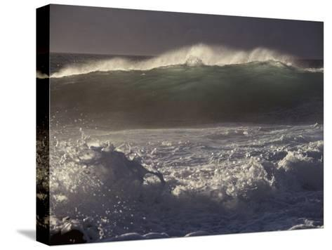 Surf Pounds a Beach in Hawaii-Marc Moritsch-Stretched Canvas Print