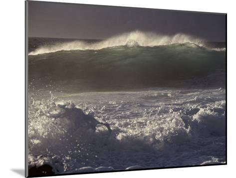 Surf Pounds a Beach in Hawaii-Marc Moritsch-Mounted Photographic Print