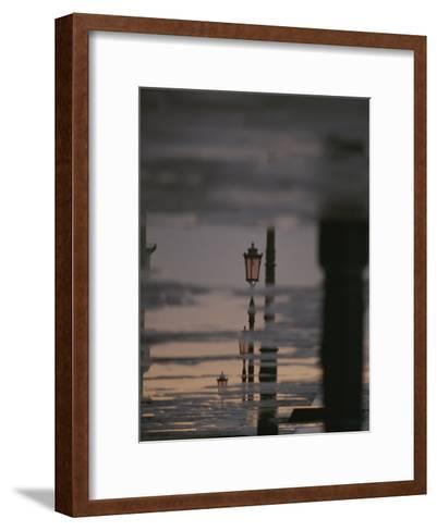 Lampposts Reflected on Wet Pavement after a Rain-Raul Touzon-Framed Art Print