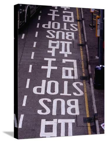 Bus Stop Markings at Wanchai, Hong Kong, China-Lawrence Worcester-Stretched Canvas Print