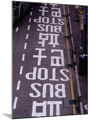 Bus Stop Markings at Wanchai, Hong Kong, China-Lawrence Worcester-Mounted Photographic Print